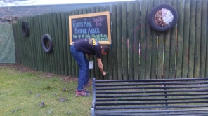 Volunteers providing a new coat of paint to our exterior fence